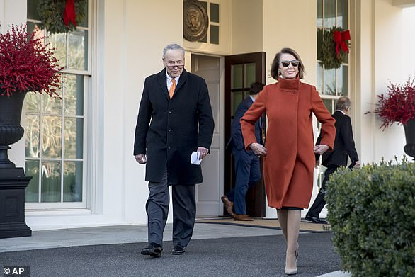 Pelosi leaving the White House in her orange coat after a meeting with President Trump in the Oval Office