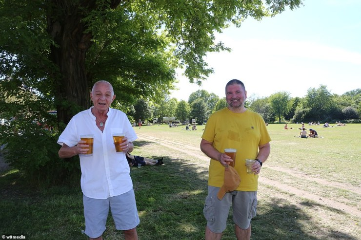 As lockdown measures begins to ease, revellers are seen taking to the outdoors near Wandsworth Common and enjoy a pint