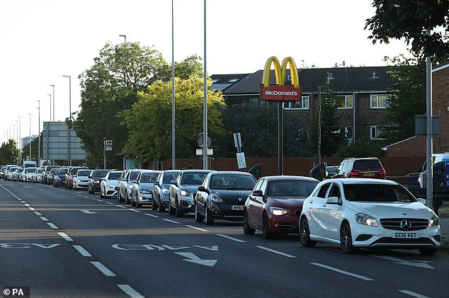 Cars line up at McDonald's driving in Hounslow, while McDonald's has reopened three of its restaurants in London, but only on driving.