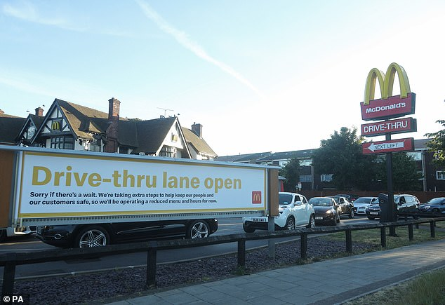 McDonald's closed all of its restaurants in the UK on Monday, March 23 - the day the government announced that the country would be locked out. In the photo: a sign announcing that McDonald's in Hounslow is once again open to customers of driving services