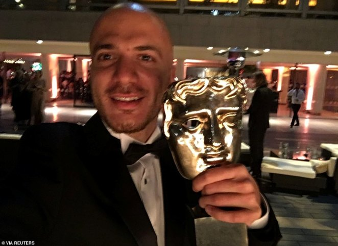 Syrian refugee and award-winning filmaker Hassan Akkad (pictured with his BAFTA in 2017) took a cleaning job to help the NHS through the pandemic. He secured another victory tonight with the dropping of the NHS surcharge for health and care workers, after getting the the Government to change its coronavirus bereavement scheme