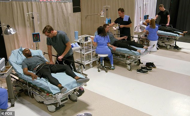 Ouch: Katzmann's suitors are hooked up to machines that simulates labor on one episode