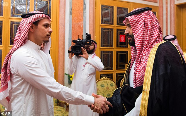 Salah Khashoggi, left, shakes hands with Saudi Crown Prince Mohammed bin Salman  during a meeting in October 2018 to discuss compensation for his father's murder