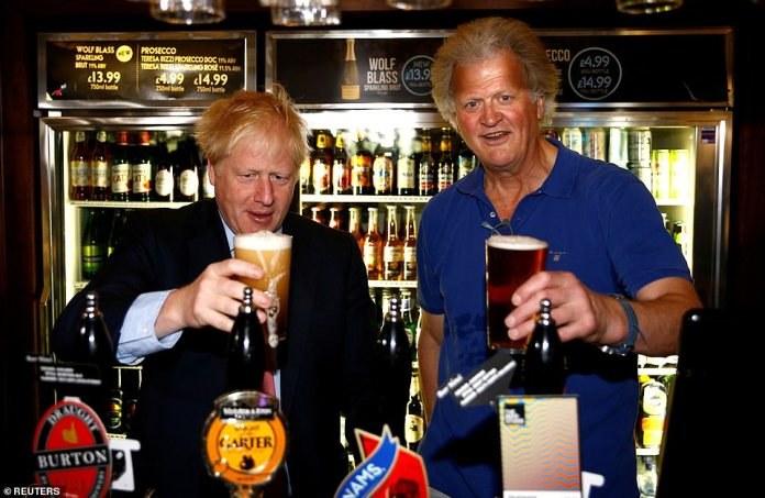 Boris Johnson, pictured with Tim Martin, president of JD Wetherspoon, faces pressure to try to open pubs and restaurants earlier to boost the economy