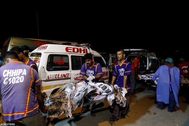 Rescue workers also used stretchers to carry bodies from the wreckage of the crashed airliner