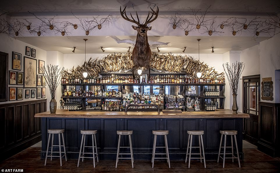 Artful:  The hotel bar at the Fife Arms in Braemar features an arching display of antlers and bottles of malt whiskies