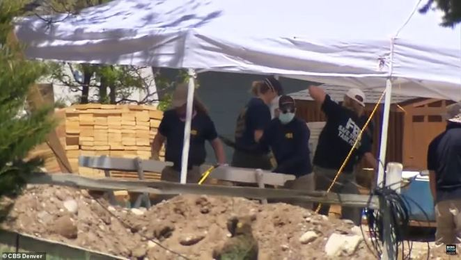Suzanne Morphew's husband was paid to lay dirt at the residential building site where Colorado cops (pictured) are now focusing their search for the missing mom-of-two who vanished without trace on Mother's Day