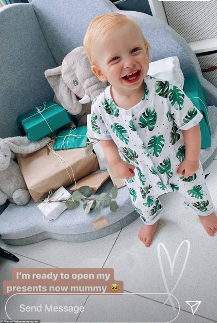 So cute: To match the jungle theme, Stacey dressed Rex in an adorable babygrow with a leafy green pattern over it