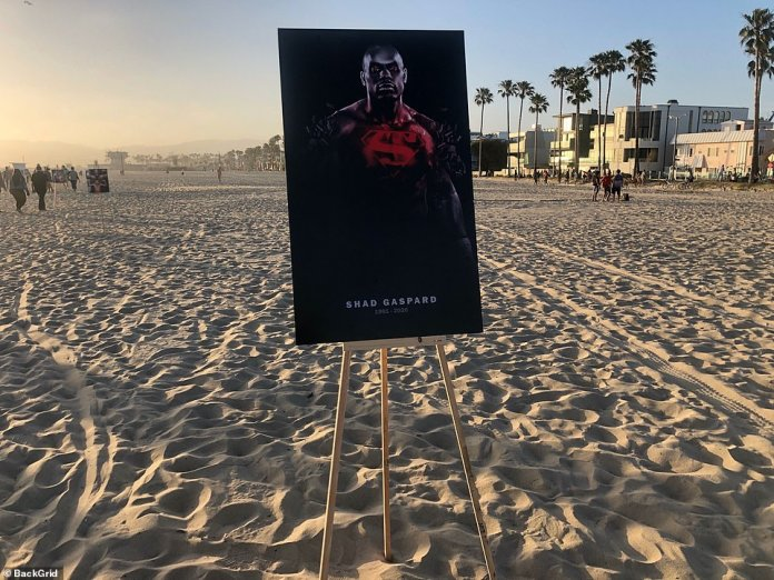 Photos of Gaspard adorn the sand of Venice Beach in memory of WWE star and father
