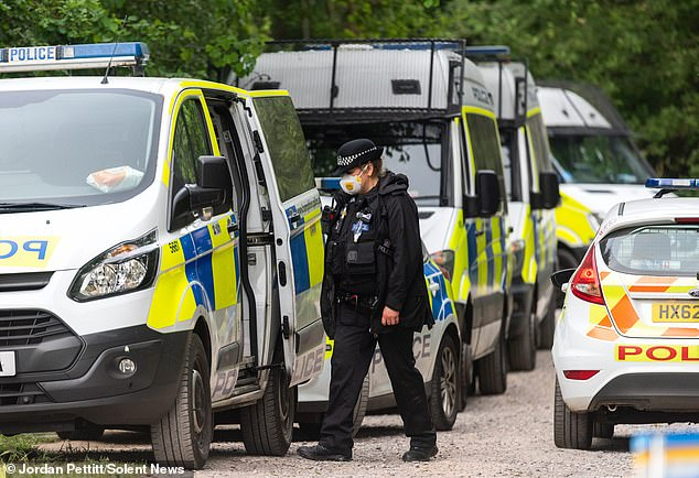 Police (pictured today) found a body in woodland during the hunt for Louise yesterday and confirmed they are treating it as suspicious