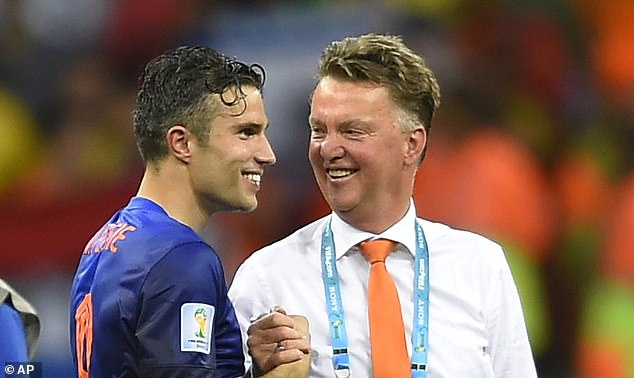 Robin van Persie (left) revealed that Louis van Gaal (right) slapped him during the 2014 World Cup