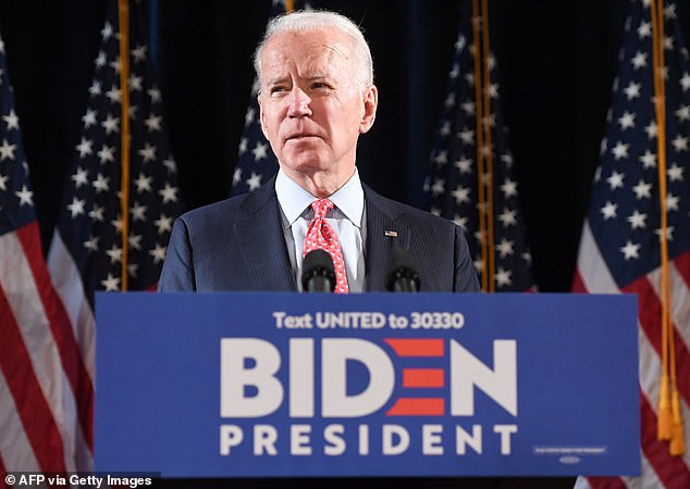 'It's time to look in the mirror and have a real soul check to see the man that has really mass incarcerated black men over the last two-and-a-half-plus decades,' Brewer added. Biden is pictured in March 2020