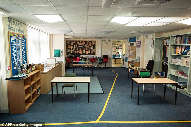 The Association of Schools and College Leaders (ASCL) said it is worrying that schools have had such little time to prepare to safely re-open. Pictured: A classroom atSlaithwaite C of E Junior and Infant School in Slaithwaite, Huddersfield, where desks have been spaced 2m apart