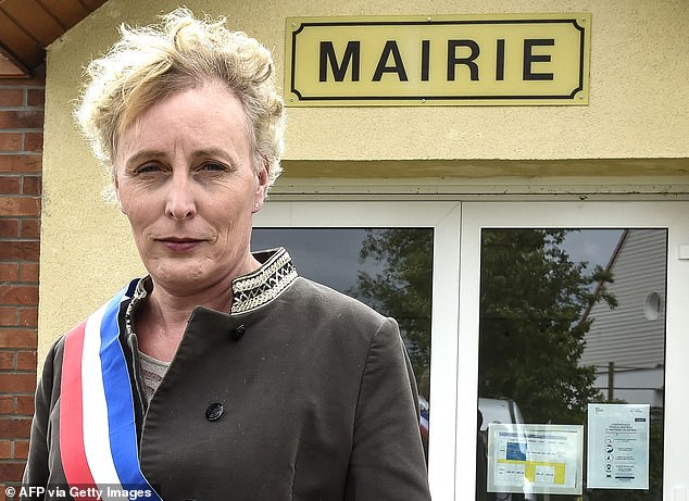 Marie Cau, first transgender woman elected mayor of France poses on May 24 in Tilloy-lez-Marchiennes, one day after being elected by the town hall
