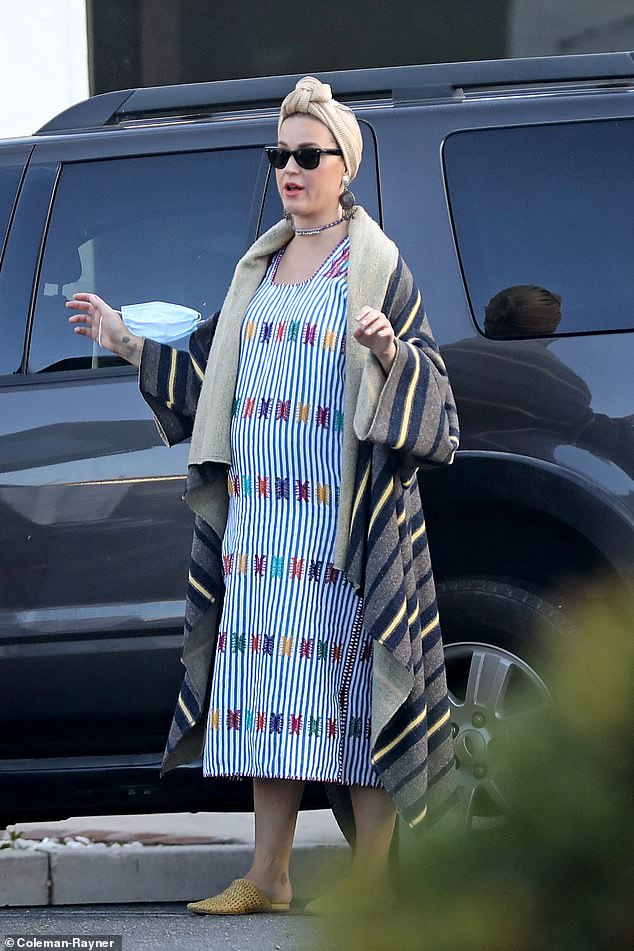 Give back: Katy Perry was seen giving money to a roadside beggar in Los Angeles on Friday.