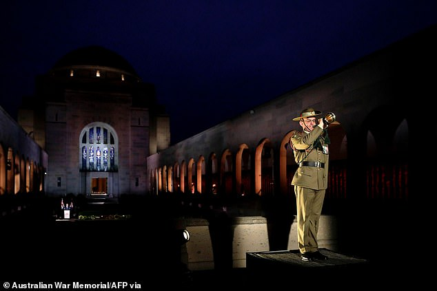 Pictured: Bugler plays the Last Post at the Australian War Memorial, Canberra, April 25. Cultural institutions are expected to open in the ACT for up to 20 people from Saturday