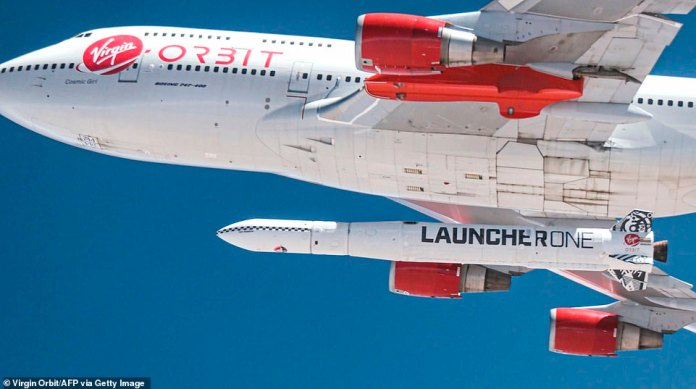 A close-up of the converted Boeing 747 with the LauncherOne rocket attached as it prepares to release it into the air for the first time