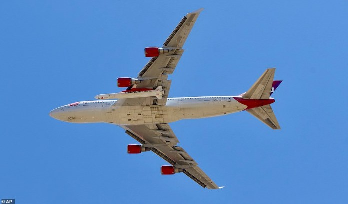 The Virgin Orbit Boeing 747-400 named Cosmic Girl is pictured taking off from Mojave Air and Space Port in the desert north of Los Angeles on Monday