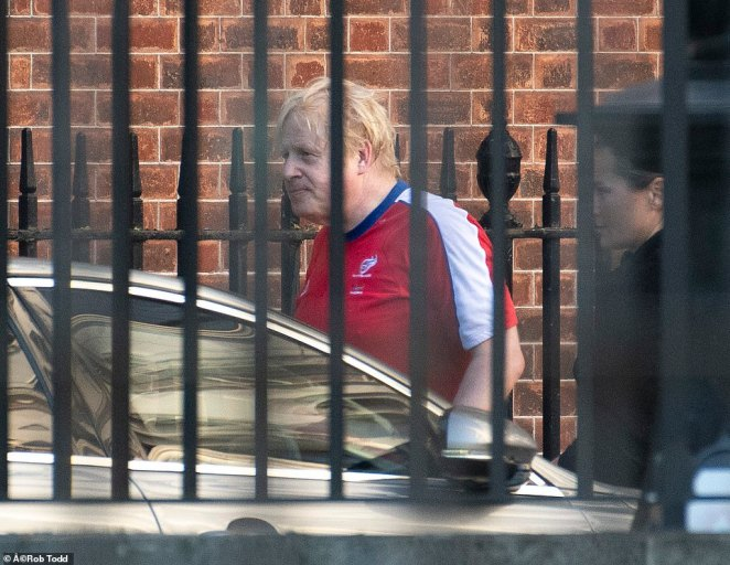 Boris Johnson, pictured in Downing Street today, said last night that his support for his top aide was not 'unconditional'