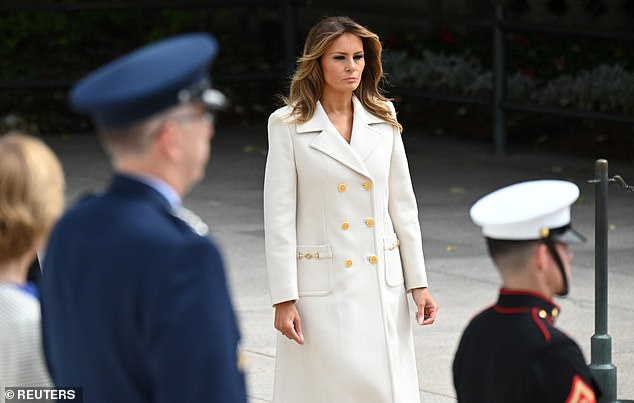 Melania Trump carried a solemn expression as she attended Monday's wreath laying ceremonyat the Tomb of the Unknown Soldier at Arlington National Cemetery
