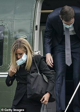 White House senior adviser Jared Kushner and White House press secretary Kayleigh McEnany exit Marine One wearing masks