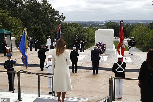 Attendees - including first lady Melania Trump - stood six feet apart for social distancing during Monday's ceremony at the Tomb of the Unknown Soldier