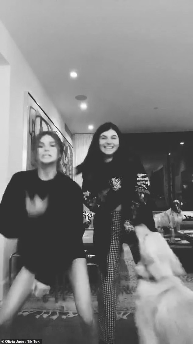 Party time: Olivia Jade and Bella are seen in this Tik Tok video this year
