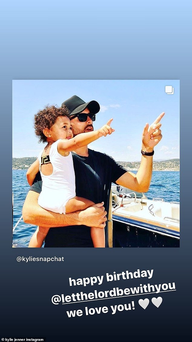 More love: Kylie shared a picture from a fan site (the photo was behind Scott's Instagram page of Kylie's 22nd birthday trip to Italy last year); she added: 'Happy birthday @letthelordbewithyou We love you!'