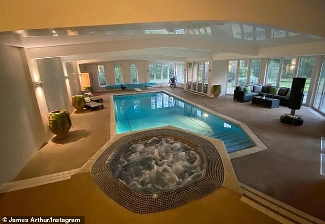 Luxury: the hitmaker shared several shots of the interior of the property, including a huge indoor pool room with French doors and a leather seating area next to the window