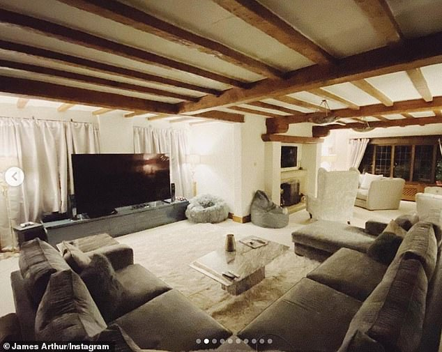 Spacious: James also took a look at his social media followers in his living room, which includes a large dark brown sofa and a cream rug