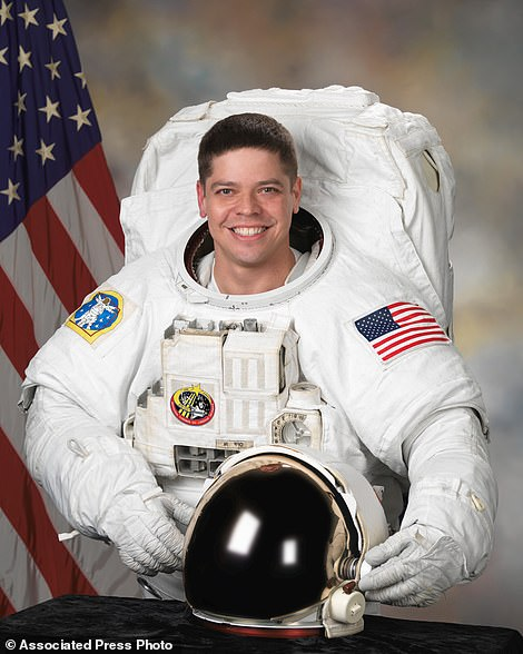This October 2007 photo made available by NASA shows astronaut Bob Behnken in an Extravehicular Mobility Unit suit used for spacewalks