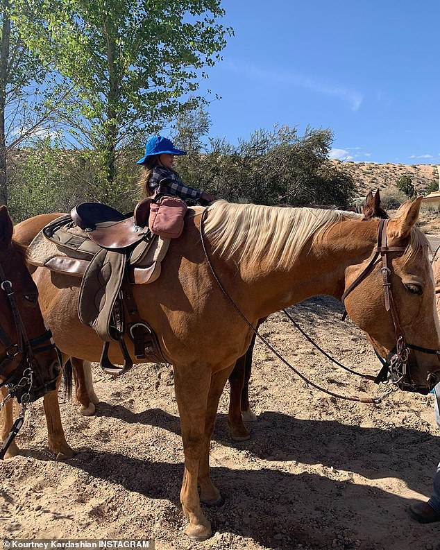 So cute: she also shared clips and videos on Tuesday of their trip to Utah, taking pictures of their children on horses exploring the beautiful terrain on horseback; Reign in photo