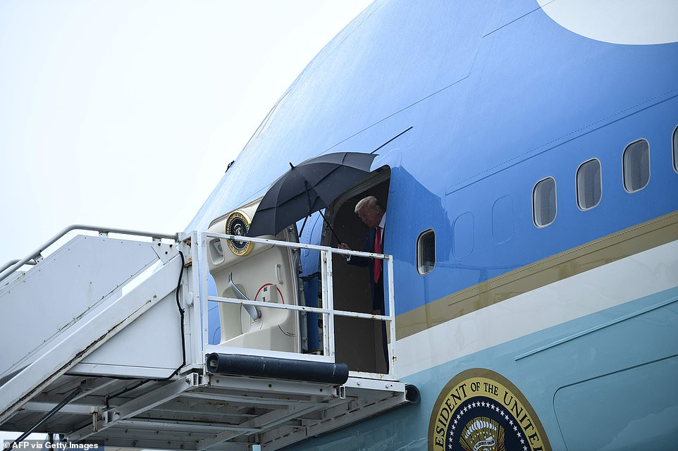President Trump stepped out of Air Force One Wednesday as he arrived to watch the launch of the SpaceX Falcon 9 rocket with the Crew Dragon spacecraft that was to take two Americans into space. The launch was scrubbed with 16 minutes to go