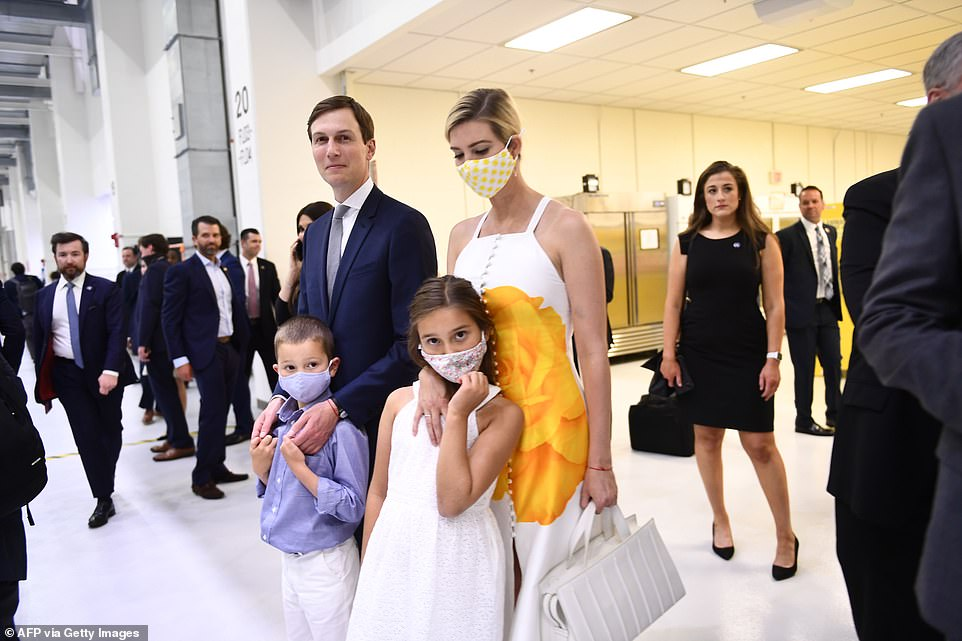 Jared Kushner goes sans mask at the Kennedy Space Center Wednesday, while Ivanka Trump and two of their children don masks. Other Trump family members including Donald Trump Jr. and his girlfriendKimberly Guilfoyle are seen over Kushner's shoulder, also choosing not to wear masks