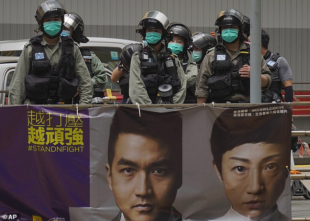 Meanwhile, riot police were deployed across Hong Kong today after mass protests yesterday as lawmakers debated a bill that would criminalise disrespect of China's national anthem