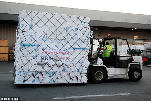 Protective masks from China are unloaded on May 25 at Paris Charles de Gaulle Airport in Roissy-en-France