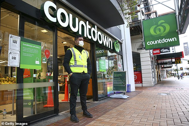 A security guard (pictured March 26, 2020) stands outside the Willis Street Countdown Supermarket in Wellington, New Zealand, during the first day of the nationwide lockdown