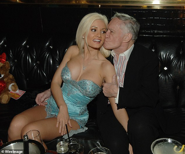 Young love: Holly was in a much-publicized polyamorous relationship from 2001 to 2008 with Playboy maestro Hefner, who passed away in 2017 at the age of 91 (pictured together in 2007)