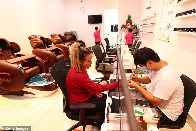 Western Australia will allow more customers inside a venue by replacing the four-square-metre distancing rule with two-square-metres. Pictured: A Gold Coast nail salon on May 16