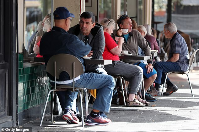Western Australia Premier Mark McGowan announced the state would enter stage three of eased coronavirus restrictions on June 6. Pictured: Customers at a Perth cafe on May 18