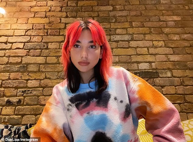 Out and a pout: Dua looked nothing short of sensational in the snap as she posed up a storm in a trio of images while pulling her very best pout for the camera