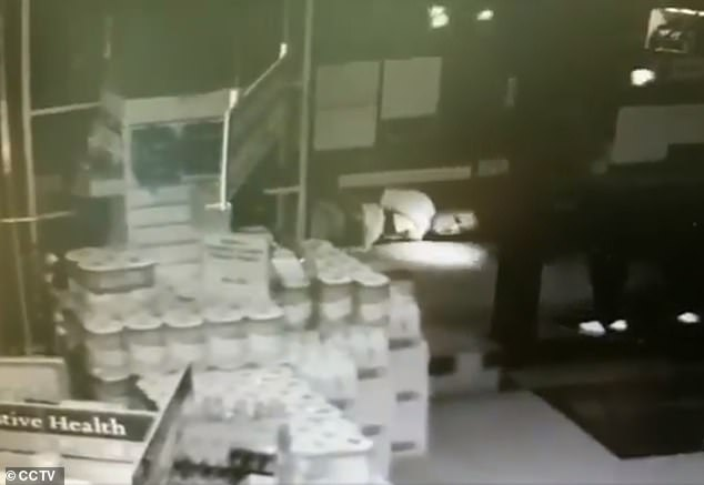 A suspect was tackled and arrested by police a short distance from the scene. The suspect can be seen in CCTV footage lying on the ground in a corridor behind a stack of toilet rolls