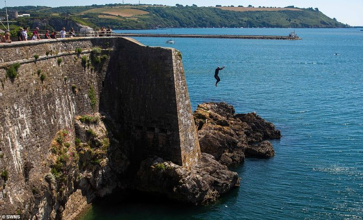 Tombstoners have also been spotted leaping into the water along Plymouth's seafront today, despite four people injured in Dorset on Saturday