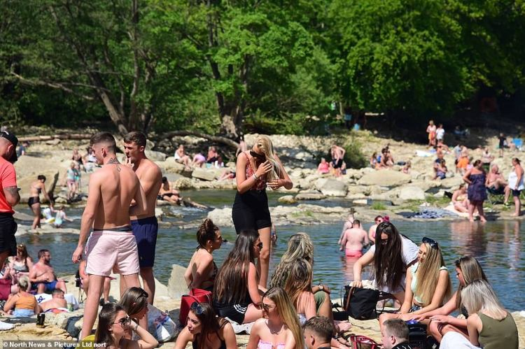 People were seen gathering at Richmond Falls in North Yorkshire as they soaked up the sun on this scorching weekend