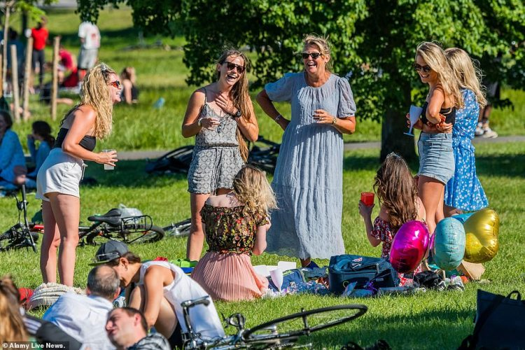Many seem to be jumping the gun on, and exceeding, the new rules for meeting groups that come into force tomorrow as they enjoy the sun in Brockwell Park, South London