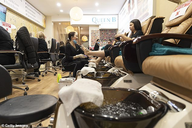 Nail salons in New South Wales reopened on Monday. Pictured is one of the first customers returning for a pedicure