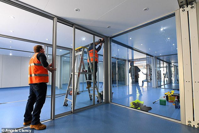 Construction workers at the COVID-19 RESUS Unit at Monash Medical Centre in Melbourne. The constriction industry accounted for almost a fifth of advertised jobs on seek, contributing to 19 per cent of ads