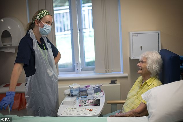 Rehab Support workers talk with patient Audrey Buckland, 92, as the first patients are admitted to the NHS Seacole Centre at Headley Court, Surrey, a disused military hospital