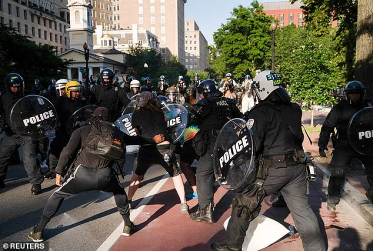 Riot police rush protestors to clear Lafayette Park and the area around it across from the White House for President Donald Trump to be able to walk through for a photo opportunity in front of St. John's Episcopal Church (seen at rear)