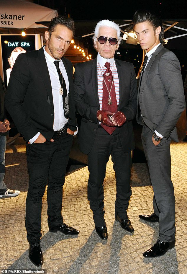 The frustrating issues surrounding the designer's estate has led to tensions between his former Chanel muse Baptiste Giabiconi (left) and his right hand man Sébastien Jondeau (right), pictured with Lagerfeld in Berlin in September 2009